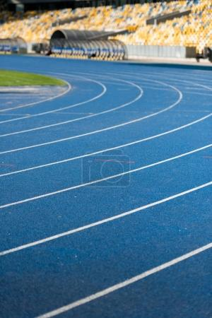 Photo for Close up view of blue running track on olympic stadium - Royalty Free Image