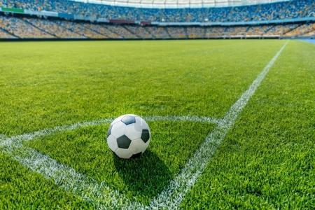 Photo for Soccer ball on grass in corner kick position on soccer field stadium - Royalty Free Image