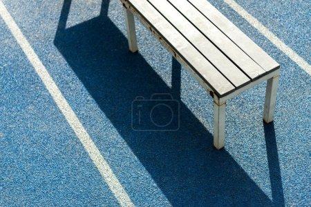 bench on running track