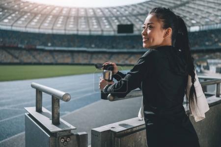 happy asian sportswoman