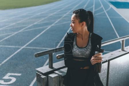 sportswoman with sport bottle