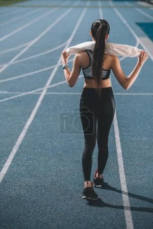 Sportswoman on running track