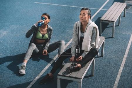 Young sportswomen on stadium