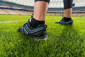 Sportswoman standing on grass