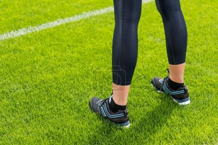 Sportswoman standing on grass