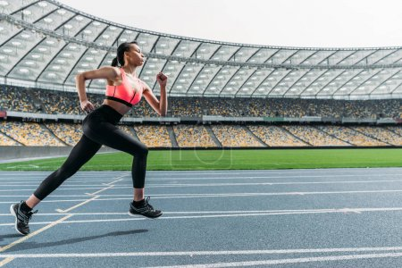 Sportswoman running on stadium