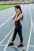 Sportswoman on running tracks
