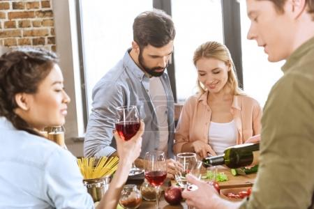 people drinking wine at home party