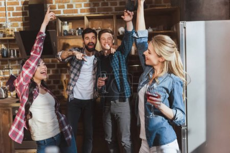 Photo for Young people partying, drinking wine and having fun at home party - Royalty Free Image