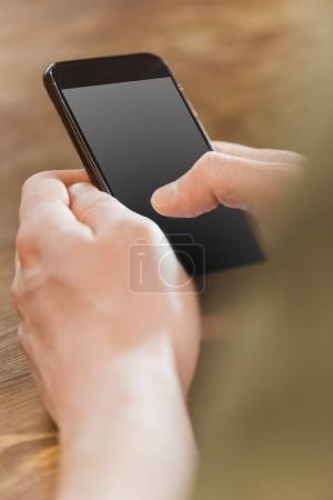 Photo for Man using smartphone with blank grey screen - Royalty Free Image