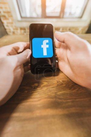 Facebook logo icon on screen