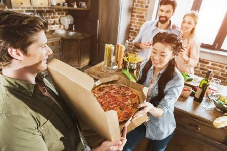 young people eating pizza