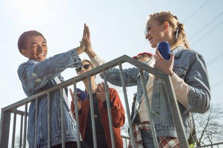 teenagers giving highfive