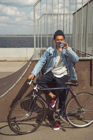 african american teenager with bicycle