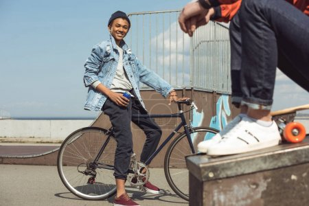 Happy teenager with bicycle