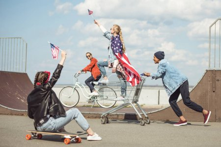 Teenagers with american flags