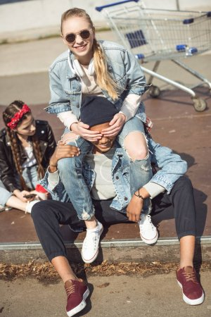 Photo for Happy teenagers group sitting together and having fun in skateboard park - Royalty Free Image