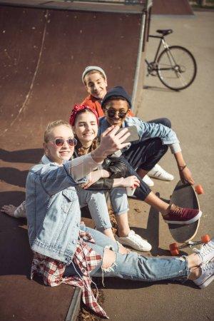 Teenagers taking selfie