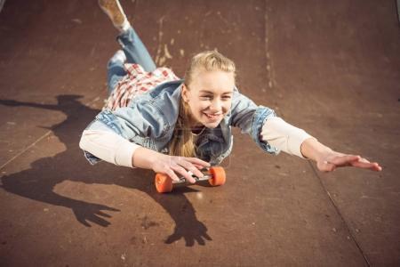 hipster girl riding skateboard