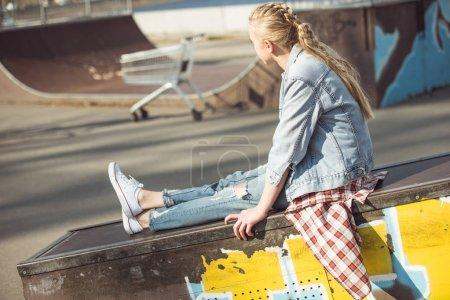 stylish girl at skateboard park