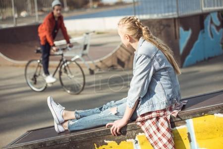 girl resting at skateboard park