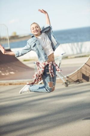 girl jumping at skateboard park