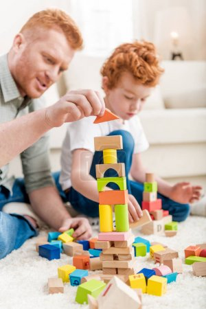 Father and son playing with constructor