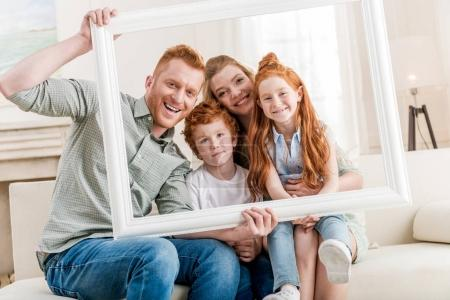 Photo for Happy redhead family looking through white frame together, big family portrait concept - Royalty Free Image