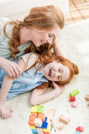 Photo for Beautiful happy mother and daughter having fun together at home, family fun at home concept - Royalty Free Image
