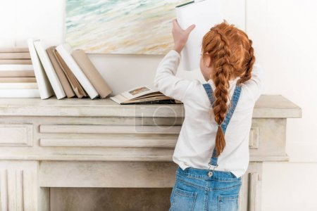 Little girl with books