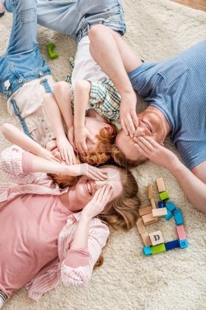 happy family lying on floor