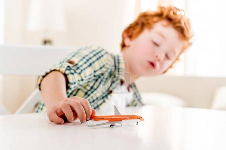 Photo for Little boy playing with toy at home, focus on foreground - Royalty Free Image