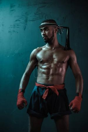 Photo for Muay Thai athlete training at Thai boxing indoors, ultimate fight concept - Royalty Free Image