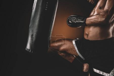 Photo for Partial view of muay thai fighter training with punching bag, action sport concept - Royalty Free Image