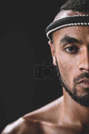 Photo for Partial view of confident muay thai fighter with mongkhon on head isolated on black - Royalty Free Image