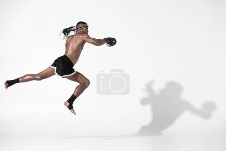 Photo for Side view of muay thai fighter training isolated on white, fight club concept - Royalty Free Image