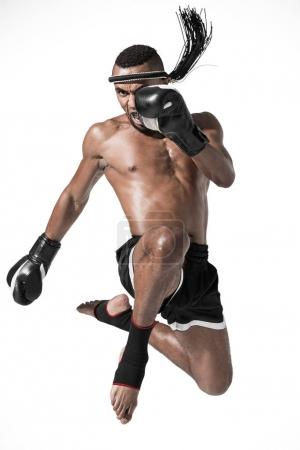 Photo for Angry muay thai fighter training isolated on white, fight club concept - Royalty Free Image