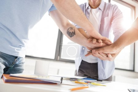 Businessmen stacking hands