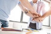 Businessmen stacking hands