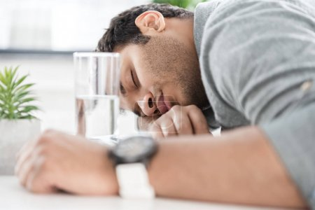 Businessman sleeping on table
