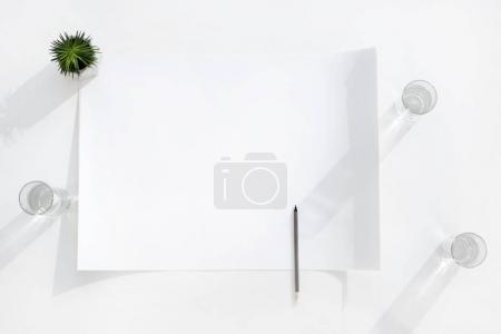 Photo for Top view of empty white banner with pencil and glasses of water, business establishment - Royalty Free Image