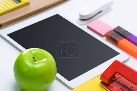 School supplies and digital tablet