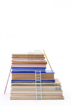 Photo for Stack of books with ladders isolated on white, educational concept - Royalty Free Image