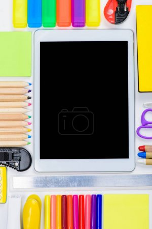 Office supplies and digital tablet