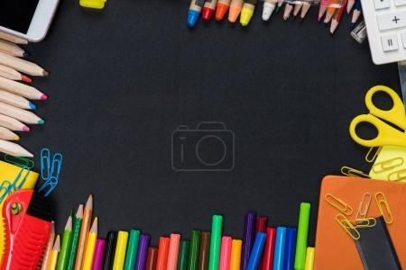 Photo for Top view of frame from colorful school and office supplies  on black - Royalty Free Image