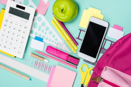 Photo for Close up view of various school supplies on colorful surface - Royalty Free Image