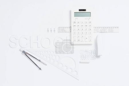 Calculator with rulers and stapler with compasses