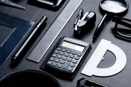 calculator with various office utensils