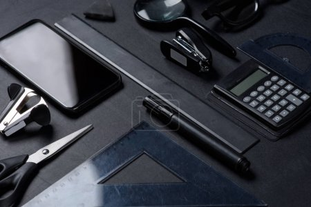 smartphone with various office utensils