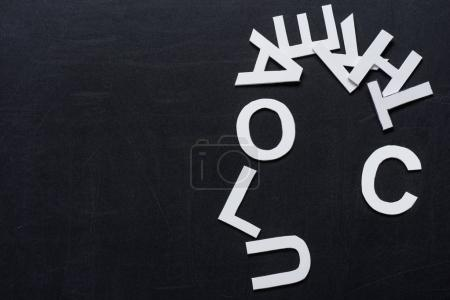 Paper letters on black chalkboard